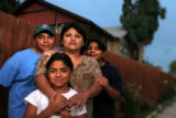 (10/21/2004) Denver, Colorado-Carmen Rocha, Denver, with her children Diego, from left, Isabel and...