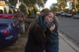 (Fort Carson, Colo., October 10, 2004) Julie Cooley gets a hug in the frontyard of her home from...