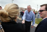 Senatorial candidate Pete Coors shakes hands with volunteers outside campaign headquarters as they...