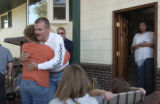 (Fountain, Colo., October 9, 2004) Master Sgt. William Cooley gets a hug from neighbor Lynne...