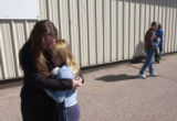 (Fort Carson, Colo., October 10, 2004) Julie Clooney comforts her daughter Brook Clooney, 10,...