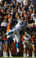 (Denver., on Sun. Oct. 10, 2004)   Denver Broncos cornerback Kelly Herndon, left, breaks up a pass...