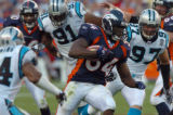 [Denver, CO]--Reuben Droughns gains yardage against the Carolina Panthers in the 4th quarter,...