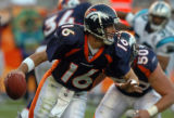 [Denver, CO]--Jake Plummer rolls out on a fourth quarter drive against the Carolina Panthers,...