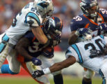 (Denver., on Sun. Oct. 10, 2004)   Denver Broncos Reuben Droughns, #34, carries Carolina Panthers...