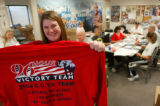 Campaign worker Kate Behnke displays a new t-shirt to be worn by the 96-Hour Team, reading: ...