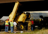 (DOUGLAS COUNTY Colo., October11, 2004) Officials look at a 30,00 pound forklift  at I-25 and...
