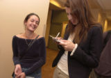 (Denver, Colo., October 11, 2004) CU student Elvira Stewart, 21, left, laughs while getting an...