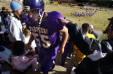 (FOUNTAIN, Co., SHOT 10/2/2004) Lake County Panthers' OL/DL Robert Damme (#55, senior) gets a pat...