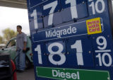 (4/19/04 DENVER, CO.) Gas prices are very high in Denver, and people are shopping around for gas...