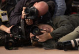 (10/08/2004) Morrison-Photojournalists gather behind President George W. Bush as he speaks to...