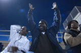 (Security Widefield, Colo., October 21, 2004) Malcolm Miller, 14, cheers on the Widefield High...