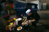 (DENVER, Co., SHOT 10/26/2004) Korean Garden B.B.Q. cook Narangerel Luvsandorj of Denver carefully...