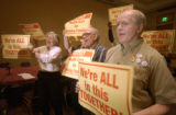 Denver, Colo.-October 27,2004-Grocery store employees (l to r) Anna Flynn, Marvin Wallingford, and...