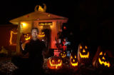 (Denver, CO., OCTOBER 20, 2004)  Eric Jacobsen decorates his front yard from Halloween through...