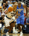Jerry Holt/Star Tribune 4/18/2004---Timberwolves Sam Cassell pushes the ball up court as Denver's...