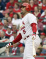 STS104 - St. Louis Cardinals' Albert Pujols watches his first -inning,  two- run home run off...