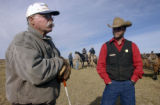 (Pinedale, Wyoming., October 4, 2004) Pinedale rancher Stan Murdock talks to game warder Bubba...