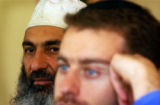 (ENGLEWOOD, CO., October 13, 2004) (Lt. to Rt.) Mohammad Noorzai, a man of Islamic faith, and...