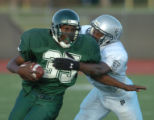 [Denver}, {Co}]--George Washington's Dave Harris (35) is stopped by Montbello's Darryl Sampson...