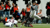 (OAKLAND, CA., OCTOBER 17, 2004)  Denver Broncos' #52, D.J. Williams, left, flips Oakland Raiders'...