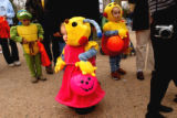 Denver, Colo., photo taken October 31, 2004-Emmalynn Mackaron (center),2, peeks out of her costum...