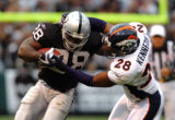 (DENVER, Co., SHOT 10/17/2004) The Denver Broncos' Kenoy Kennedy #28 (S) brings down the Oakland...