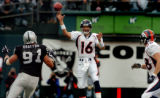 (OAKLAND, CA., OCTOBER 17, 2004)  Denver Broncos' quarterback #16, Jake Plummer, center, throws to...