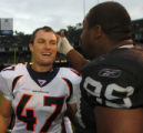 (OAKLAND, CA., OCTOBER 17, 2004)  Denver Broncos' #47, John Lynch, left, and former teammate,...