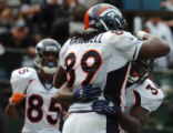 (OAKLAND, CA., OCTOBER 17, 2004)  Denver Broncos' #89, Dwayne Carswell, center, is hugged by #34,...