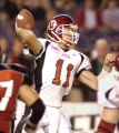 CALI109 - Utah quarterback Alex Smith gets a pass off under pressure during the first half of his...