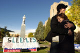 (10/18/2004) Boulder, Colorado-CU student Jennifer Mueller, 19, hugs Mike Playte, 19, on the lawn...