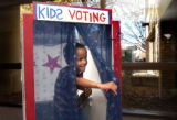 (Denver, Colo., Nov. 2, 2004) Ryan Herrera, 5, of Elizabeth, emerges from a voting booth after...