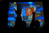 (11/02/04, Denver, CO) People were cheering as Colorado voting scores flashed up on the screen at...