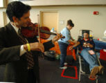 (DENVER, CO., OCTOBER 19, 2004)   Violinist, Michael G. Marsh, left, perfroms for blood donor,...