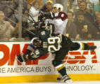 (DALLAS, TX., APRIL 12, 2004)  Colorado Avalanche's #6, Bob Boughner, top, gets piinned against...