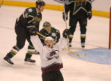 (DALLAS, TX., APRIL 14, 2004)  Colorado Avalanche's #40, Marek Svatos, center, celebrates his game...