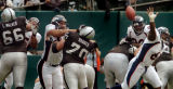 (OAKLAND, CA., OCTOBER 17, 2004)  Denver Broncos' #61,  barely misses blocking first quarter field...
