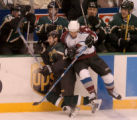 (DALLAS, TX., APRIL 14, 2004)  Colorado Avalanche's #13, Dan Hinote, right, drives Dallas Stars'...