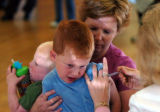 Lakewood, Co.,  October 20, 2004  -  Michelle Rice of Brighton holds her son, Colton, 3, as he...
