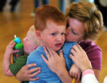 Lakewood, Co.,  October 20, 2004  -  Michelle Rice of Brighton kisses her son, Colton, 3, after he...