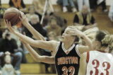 Brighton, CO December 16, 2005 Grand Junction's Raysha Ritter  (32) battles for a rebound in the...