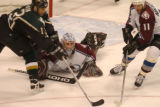 (DALLAS, TX., APRIL 14, 2004)  Colorado Avalanche goalie David Aebischer, center, dives out for a...