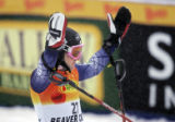 American skiier Ted Ligety raises his arms in celebration after crossing the finish line at the...