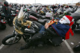 Russell Rawlings (cq), lounges on his motorcycle before the start of the 20th Annual Toy Run to...