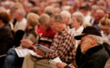 JPM048  Gene s. Ball (cq), of Lakewood, reads material with hundreds of Medicare participants...