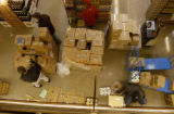 A group of men work to stock shelves with new food within the Whole Foods newest store in Colorado...