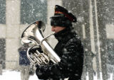Matt Sims (cq), from the Salvation Band, plays the Euphonium in the cold and snow on the 16th...