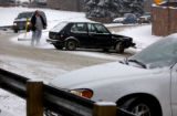 (BOULDER., Colo., Dec. 6, 2005) A motorist directs traffic Tuesday Dec. 6, 2005 in Boulder on 17th...