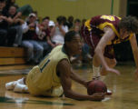 Rocky Mountain's Trent Wahlfeldt tries to steal the ball from Aurora's Stephen Franklin (11) after...